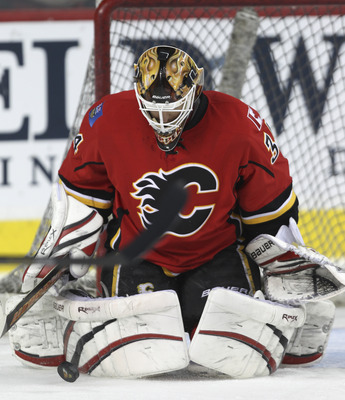 CALGARY, CANADA - MARCH 04: Miikka Kiprusoff #34 of the Calgary Flames makes a save in the warm up before NHL action against the Columbus Blue Jackets on March 4, 2011 at the Scotiabank Saddledome in Calgary, Alberta, Canada. (Photo by Mike Ridewood/Getty