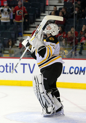 CALGARY,CANADA - FEBRUARY 22:  Tim Thomas #30 of the Boston Bruins celebrates a win against the Calgary Flames looks on during their NHL game at Scotiabank Saddledome, February 22,2011 in Calgary, Alberta, Canada.(Photo By Dave Sandford/Getty Images)