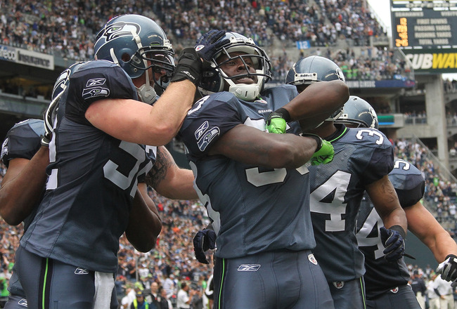 SEATTLE - SEPTEMBER 26:  Kick returner Leon Washington #33 of the Seattle Seahawks (C) celebrates with teammates after scoring a touchdown on a 101 yard kickoff return in the third quarter against the San Diego Chargers at Qwest Field on September 26, 201