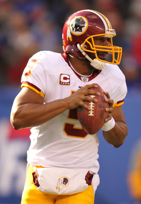 EAST RUTHERFORD, NJ - DECEMBER 05:  Donovan McNabb #5 of the Washington Redskins passes the  ball against the New York Giants during their game on December 5, 2010 at The New Meadowlands Stadium in East Rutherford, New Jersey.  (Photo by Al Bello/Getty Im