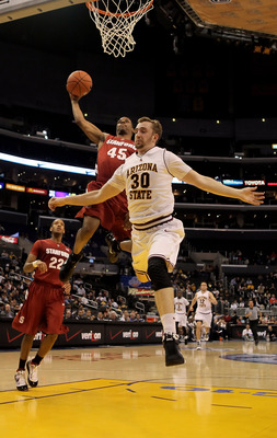 LOS ANGELES, CA - MARCH 11:  Jeremy Green #45 of the Stanford Cardinal drives to the basket past Rihards Kuksiks #30 of the Arizona State Sun Devils in the second half during the Quarterfinals of the Pac-10 Basketball Tournament at Staples Center on March