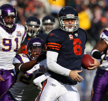 CHICAGO - NOVEMBER 14: Jay Cutler #6 of the Chicago Bears runs for a first down as Ray Edwards #91 and Madieu Williams #20 of the Minnesota Vikings give chase at Soldier Field on November 14, 2010 in Chicago, Illinois. The Bears defeated the Vikings 27-13