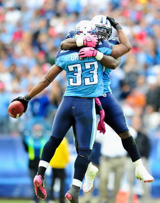 NASHVILLE, TN - OCTOBER 03:  Stephen Tulloch #55 and Michael Griffin #33 of the Tennessee Titans celebrate after Griffin's interception against the Denver Broncos at LP Field on October 3, 2010 in Nashville, Tennessee. Denver won 26-20.  (Photo by Grant H