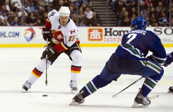 VANCOUVER, CANADA - JANUARY 22: Olli Jokinen #13 of the Calgary Flames skates with the puck during a game against the  Vancouver Canucks on January 22, 2011 at Rogers Arena in Vancouver, BC, Canada.  (Photo by Rich Lam/Getty Images)