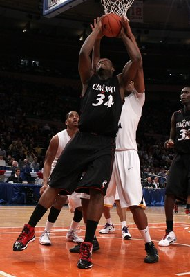 NEW YORK - MARCH 11: Yancy Gates #34 of the Cincinnati Bearcats goes up with the ball against the West Virginia Mountaineers during the quarterfinal of the 2010 NCAA Big East Tournament at Madison Square Garden on March 11, 2010 in New York City.  (Photo