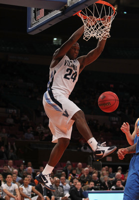 NEW YORK - NOVEMBER 24:  Corey Stokes #24 of the Villanova Wildcats dunks against the UCLA Bruins during their preseason NIT semifinal at Madison Square Garden on November 24, 2010 in New York City.  (Photo by Nick Laham/Getty Images)