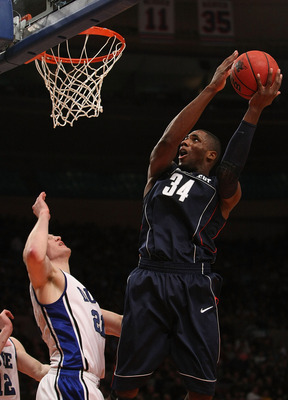 NEW YORK - NOVEMBER 27: Alex Oriakhi #34 of the Connecticut Huskies shoots the ball against the Duke Blue Devils during the Championship game at Madison Square Garden on November 27, 2009 in New York, New York.  (Photo by Nick Laham/Getty Images)