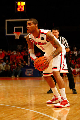 NEW YORK, NY - DECEMBER 20:  D.J. Kennedy #1 of the St. John's Red Storm looks to pass the ball against the Davidson Wildcats during the Madison Square Garden Holiday Festival at Madison Square Garden on December 20, 2010 in New York City.  (Photo by Chri