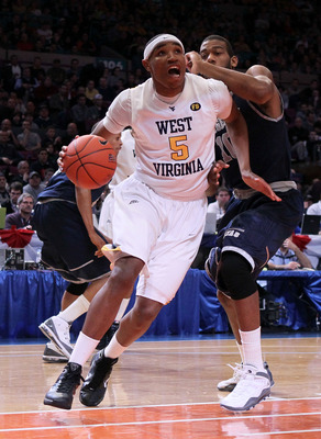 NEW YORK - MARCH 13:  Kevin Jones #5 of the West Virginia Mountaineers drives with the ball against Greg Monroe #10 of the Georgetown Hoyas during the championship of the 2010 NCAA Big East Tournament at Madison Square Garden on March 13, 2010 in New York