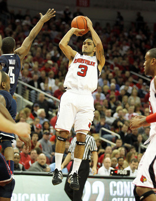 LOUISVILLE, KY - FEBRUARY 18:  Peyton Siva #3 of the Louisville Cardinals shoots the ball during the Big East Conference game against the Connecticut Huskies at the KFC Yum! Center on February 18, 2011 in Louisville, Kentucky.  (Photo by Andy Lyons/Getty