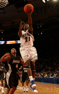 NEW YORK - MARCH 09: Jeremy Hazell #21 of the Seton Hall Pirates drives to the hoop against Sharaud Curry#4 of the Providence Friars during the first round game of the Big East Basketball Tournament at Madison Square Garden on March 9, 2010 in New York, N