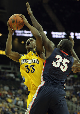 KANSAS CITY, MO - NOVEMBER 23:  Jimmy Butler #33 of the Marquette Golden Eagles shoots over Sam Dower #35 of the Gonzaga Bulldogs during the CBE Classic consolation game on November 23, 2010 at the Sprint Center in Kansas City, Missouri.  (Photo by Jamie