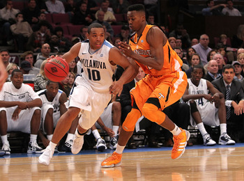 NEW YORK - NOVEMBER 26:  Corey Fisher #10 of the Villanova Wildcats drives to the basket alongside Scotty Hopson #32 of the Tennessee Volunteers during the Championship game at Madison Square Garden on November 26, 2010 in New York City.  (Photo by Nick L