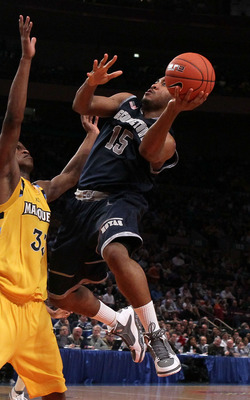 NEW YORK - MARCH 12: Austin Freeman #15 of the Georgetown Hoyas goes up with the ball against Jimmy Butler #33 the Marquette Golden Eagles during the semifinal of the 2010 Big East Tournament at Madison Square Garden on March 12, 2010 in New York City.  (