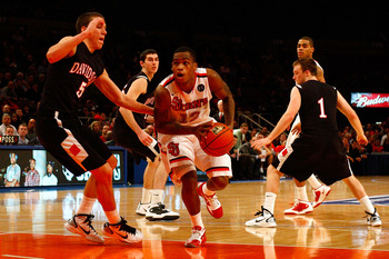 NEW YORK, NY - DECEMBER 20:  Dwight Hardy #12 of the St. John's Red Storm drives against JP Kuhlman #5 and Brendan McKillop #1 of the Davidson Wildcats during the Madison Square Garden Holiday Festival at Madison Square Garden on December 20, 2010 in New