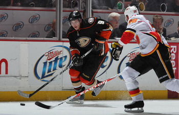 ANAHEIM, CA - DECEMBER 10:  Bobby Ryan #9 of the Anaheim Ducks is pursued by Robyn Regehr #28 of the Calgary Flames for the puck at the Honda Center on December 10, 2010 in Anaheim, California.  (Photo by Jeff Gross/Getty Images)