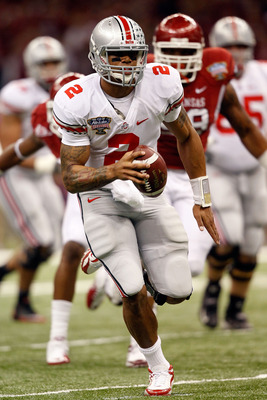 NEW ORLEANS, LA - JANUARY 04:  Terrelle Pryor #2 of the Ohio State Buckeyes runs with the football against the Arkansas Razorbacks in the first quarter during the Allstate Sugar Bowl at the Louisiana Superdome on January 4, 2011 in New Orleans, Louisiana.