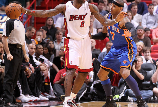 MIAMI, FL - FEBRUARY 27:  LeBron James #6 of the Miami Heat is guarded by Carmelo Anthony #7 of the New York Knicks looks on during a game at American Airlines Arena on February 27, 2011 in Miami, Florida. NOTE TO USER: User expressly acknowledges and agr