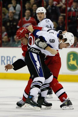 RALEIGH, NC - FEBRUARY 20:  Tim Conboy #38 of the Carolina Hurricanes fights Steve Downie #9 of the Tampa Bay Lightning during the game on February 20, 2009 at RBC Center in Raleigh, North Carolina.  (Photo by Kevin C. Cox/Getty Images)