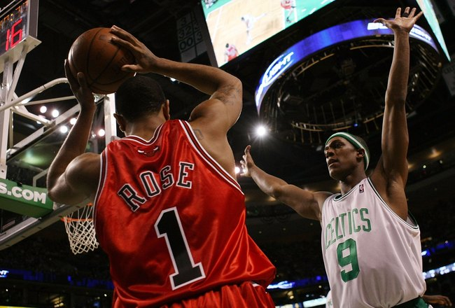 BOSTON - MAY 02:  Rajon Rondo #9 of the Boston Celtics tries to keep Derrick Rose #1 of the Chicago Bulls from passing the ball in bounds in Game Seven of the Eastern Conference Quarterfinals during the 2009 NBA Playoffs at TD Banknorth Garden on May 2, 2
