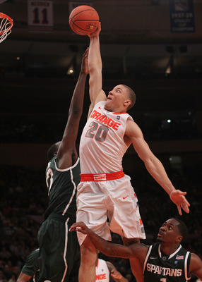 NEW YORK, NY - DECEMBER 07:  Brandon Triche #30 of Syracuse Orange goes up for the dunk against the Michigan State Spartans during their game at the Jimmy V Classic at Madison Square Garden on December 7, 2010 in New York City.  (Photo by Nick Laham/Getty