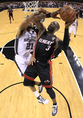 SAN ANTONIO, TX - MARCH 04:  Guard Dwyane Wade #3 of the Miami Heat takes a shot against Tim Duncan #21 of the San Antonio Spurs at AT&T Center on March 4, 2011 in San Antonio, Texas.   NOTE TO USER: User expressly acknowledges and agrees that, by downloa