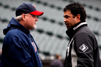 CHICAGO - SEPTEMBER 30:  Manager Ozzie Guillen #13 (R) of the Chicago White Sox and manager Ron Gardenhire #35 of the Minnesota Twins talk during batting practice prior to the American League Central Division Tiebreaker game at U.S. Cellular Field on Sept