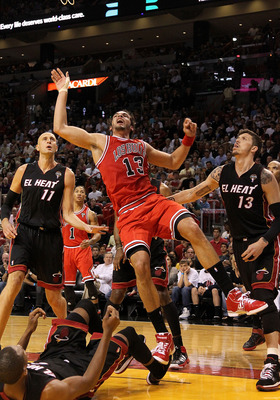 MIAMI, FL - MARCH 06:  Joakim Noah #13 of the Chicago Bulls takes an awkward shot  during a game against the Miami Heat at American Airlines Arena on March 6, 2011 in Miami, Florida. NOTE TO USER: User expressly acknowledges and agrees that, by downloadin