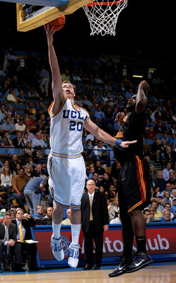 WESTWOOD, CA - JANUARY 16: Michael Roll #20 of the UCLA Bruins shoots over Leonard Washington #4 of the USC Trojans on January 16, 2010 at Pauley Pavillion in Westwood, California.   USC won 67-46.  (Photo by Stephen Dunn/Getty Images)
