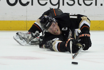 ANAHEIM, CA - FEBRUARY 27:  Ryan Getzlaf #15 of the Anaheim Ducks lunges for the puck in the third period against the Colorado Avalanche at Honda Center on February 27, 2011 in Anaheim, California.  The Ducks defeated the Avalanche 3-2. (Photo by Jeff Gro