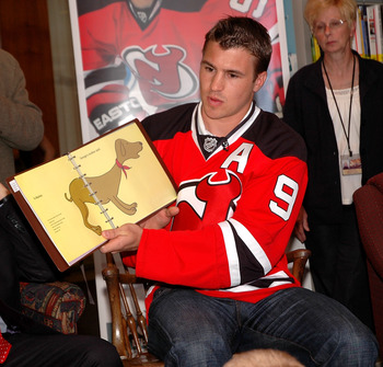 TRENTON, NJ - MAY 25: New Jersey Devils forward Zach Parise reads a book to young students during Zach Parise Reads to Students at the State Library on May 25, 2010 in Trenton, New Jersey. (Photo by Andy Marlin/Getty Images for the New Jersey Devils)