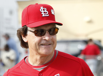 JUPITER, FL - FEBRUARY 17: Manager Tony La Russa #10 of the St. Louis Cardinals talks to a member of the media outside the clubhouse at Roger Dean Stadium on February 17, 2011 in Jupiter, Florida. (Photo by Joel Auerbach/Getty Images)