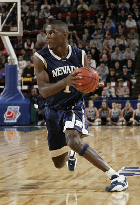 SEATTLE - MARCH 18:  Kirk Snyder #1 of the University of Nevada Wolf Pack drives against the Michigan State University Spartans during Game 3 of the 1st Round of the NCAA Division I Men's Basketball Tournament at Key Arena on March 18, 2004 in Seattle, Wa