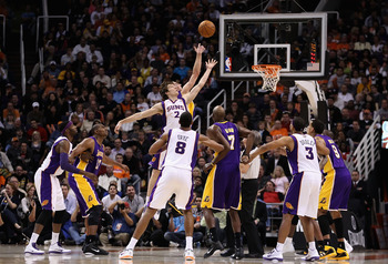 PHOENIX, AZ - JANUARY 05:  Goran Dragic #2 of the Phoenix Suns reaches for a jump ball against the Los Angeles Lakers during the NBA game at US Airways Center on January 5, 2011 in Phoenix, Arizona. The Lakers defeated the Suns 99-95.  NOTE TO USER: User