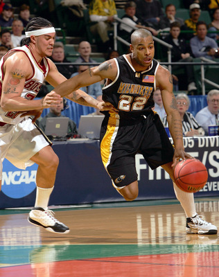 CLEVELAND - MARCH 19:  Ed McCants #22 of the Wisconsin-Milwaukee Panthers drives past Sean Marshall #23 of the Boston College Eagles during the second round of the 2005 NCAA Championship on March 19, 2005 at the Wolstein Center in Cleveland, Ohio.  (Photo