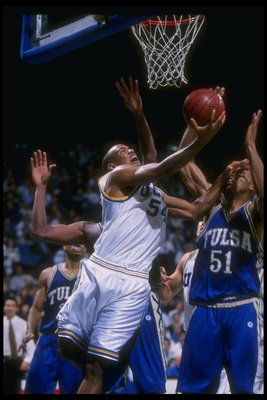 20 Nov 1996:  Guard Kris Johnson of the UCLA Bruins (left) goes up for two as Tulsa Golden Hurricane forward Michael Ruffin (right) covers him during a game at Pauley Pavilion in Los Angeles, California.  Tulsa won the game, 77-76. Mandatory Credit: Brian
