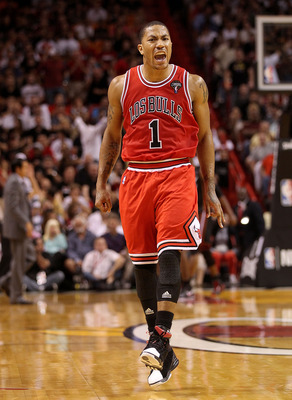 MIAMI, FL - MARCH 06:  Derrick Rose #1 of the Chicago Bulls reacts after making a key 3 pointer during a game against the Miami Heat at American Airlines Arena on March 6, 2011 in Miami, Florida. NOTE TO USER: User expressly acknowledges and agrees that,