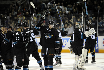 SAN JOSE, CA - MARCH 3: Dany Heatley #15 and his teammates of the San Jose Sharks salute the crowd after the Sharks defeated the Detroit Red Wings 3-1 in an NHL hockey game at the HP Pavilion on March 3, 2011 in San Jose, California. (Photo by Thearon W.
