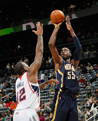 ATLANTA, GA - DECEMBER 11:  Roy Hibbert #55 of the Indiana Pacers against Josh Powell #12 of the Atlanta Hawks at Philips Arena on December 11, 2010 in Atlanta, Georgia.  NOTE TO USER: User expressly acknowledges and agrees that, by downloading and/or usi