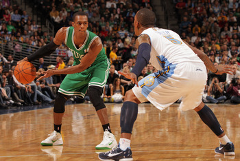 DENVER, CO - FEBRUARY 24:  Rajon Rondo #9 of the Boston Celtics controls the ball against J.R. Smith #5 of the Denver Nuggets during NBA action at the Pepsi Center on February 24, 2011 in Denver, Colorado. NOTE TO USER: User expressly acknowledges and agr