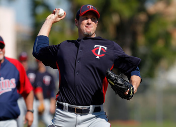 FORT MYERS, FL - FEBRUARY 23:  Pitcher Joe Nathan #36 of the Minnesota Twins throws during a spring training workout session at Hammond Stadium on February 23, 2011 in Fort Myers, Florida.  (Photo by J. Meric/Getty Images)