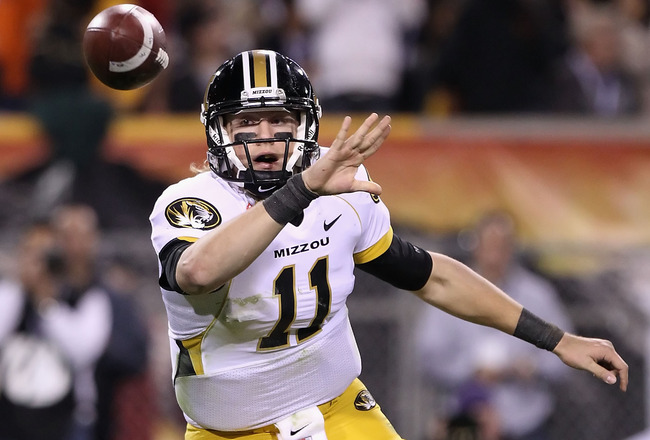 TEMPE, AZ - DECEMBER 28:  Quarterback Blaine Gabbert #11 of the Missouri Tigers flips the ball during the Insight Bowl against the Iowa Hawkeyes at Sun Devil Stadium on December 28, 2010 in Tempe, Arizona.  (Photo by Christian Petersen/Getty Images)