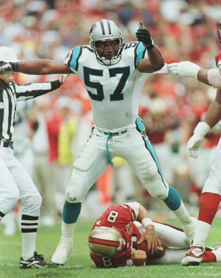 8 Dec 1996:  Lamar Lathon #57 of the Carolina Panters stands over quarterback Steve Young of the San Francisco 49ers after he was sacked in the second half during their game at 3Com Park in San Francisco, California. The Panthers beat the 49ers 30-24. Man