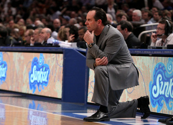 NEW YORK - MARCH 12: Head coach Mike Brey of the Notre Dame Fighting Irish looks on from the bench against the West Virginia Mountaineers during the semifinal of the 2010 Big East Tournament at Madison Square Garden on March 12, 2010 in New York City.  (P