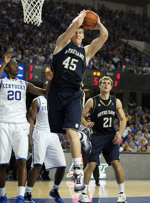 LOUISVILLE, KY - DECEMBER 08:  Jack Cooley #45 of the Notre Dame Fighting Irish grabs a rebound during the game against the Kentucky Wildcats in the 2010 DIRECTV SEC/BIG EAST Invitational at Freedom Hall on December 8, 2010 in Louisville, Kentucky.  (Phot
