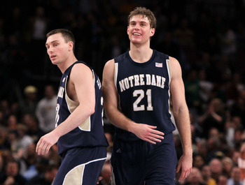 NEW YORK - MARCH 11: Ben Hansbrough #23 and Tim Abromaitis #21 of the Notre Dame Fighting Irish react after defeating the Pittsburgh Panthers during the quarterfinal of the 2010 NCAA Big East Tournament at Madison Square Garden on March 11, 2010 in New Yo