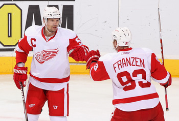 GLENDALE, AZ - MARCH 05:  Nicklas Lidstrom #5 and Johan Franzen #93 of the Detroit Red Wings celebrate after Franzen scored a first period power play goal against the Phoenix Coyotes during the NHL game at Jobing.com Arena on March 5, 2011 in Glendale, Ar