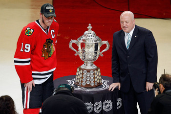 CHICAGO - MAY 23:  Jonathan Toews #19 of the Chicago Blackhawks poses with National Hockey League Deputy Commissioner Bill Daly as Toews receives the Campbell Trophy for winning the Western Conference after the Blackhawks 4-2 victory in Game Four of the W