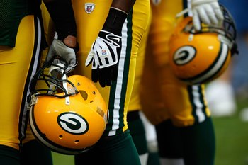 GREEN BAY, WI - SEPTEMBER 08:  A detailed picture of Green Bay Packers players holding their helmets before taking on the Minnesota Vikings on September 8, 2008 at Lambeau Field in Green Bay, Wisconsin.  (Photo by Dilip Vishwanat/Getty Images)