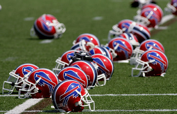 PITTSFORD, NY - JULY 25: Helmets of the Buffalo Bills lay on the field during Training Camp on July 25, 2008 at Saint John Fisher College in Pittsford, New York.  (Photo by Rick Stewart/Getty Images)